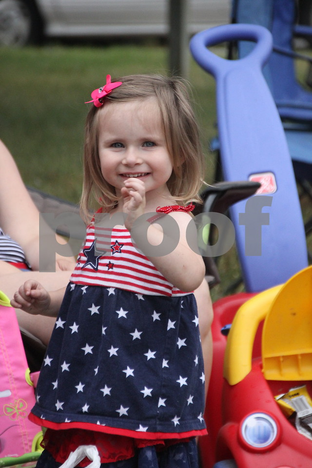 Watching the parade and waving at the camera is: Rylan Long. The Otho Fourth of July Parade took place in Otho on July 4, 2016.