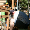 Chris helping with the final trim for the deck  railing.  The day was pretty hot, but we  whacked away and got lots done!!