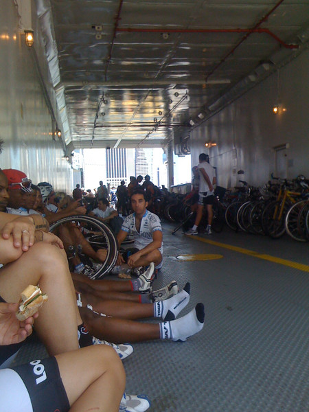 On a boat going to a bike race
