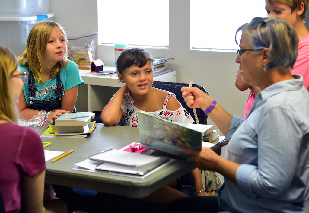 . BROOMFIELD, CO - JULY 31 2018 Kamryn Wimmer, left, and Rylee Weibel listen to a poetry reading from teacher Deb Hayward during the Jump Start Literacy Camp in the Lutheran Church of Hope in Broomfield on Tuesday July 31, 2018. For more photos go to broomfieldenterprise.com. (Photo by Paul Aiken Daily Camera)