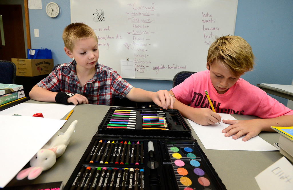 . BROOMFIELD, CO - JULY 31 2018 Evan Walters, left, and Elliott Hoyland work on drawings based on a poetry reading to show teacher Deb Hayward during the Jump Start Literacy Camp in the Lutheran Church of Hope in Broomfield on Tuesday July 31, 2018. For more photos go to broomfieldenterprise.com. (Photo by Paul Aiken Daily Camera)