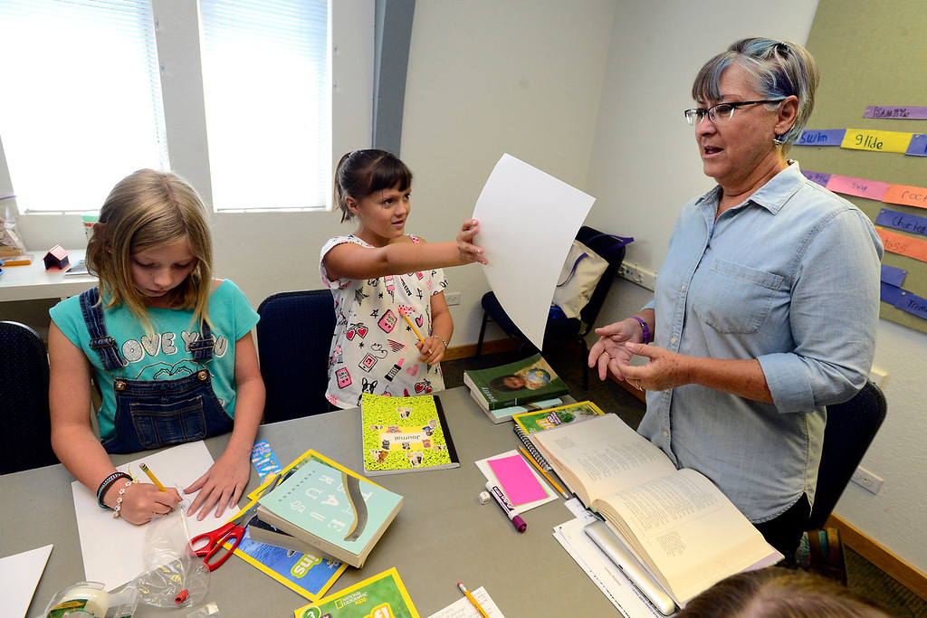 . BROOMFIELD, CO - JULY 31 2018 Kamryn Wimmer, left, and Rylee Weibel work on drawings based on a poetry reading to show teacher Deb Hayward during the Jump Start Literacy Camp in the Lutheran Church of Hope in Broomfield on Tuesday July 31, 2018. For more photos go to broomfieldenterprise.com. (Photo by Paul Aiken Daily Camera)