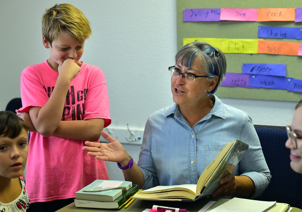 . BROOMFIELD, CO - JULY 31 2018 Elliot Hoyland listens to a poetry reading from teacher Deb Hayward during the Jump Start Literacy Camp in the Lutheran Church of Hope in Broomfield on Tuesday July 31, 2018. For more photos go to broomfieldenterprise.com. (Photo by Paul Aiken Daily Camera)
