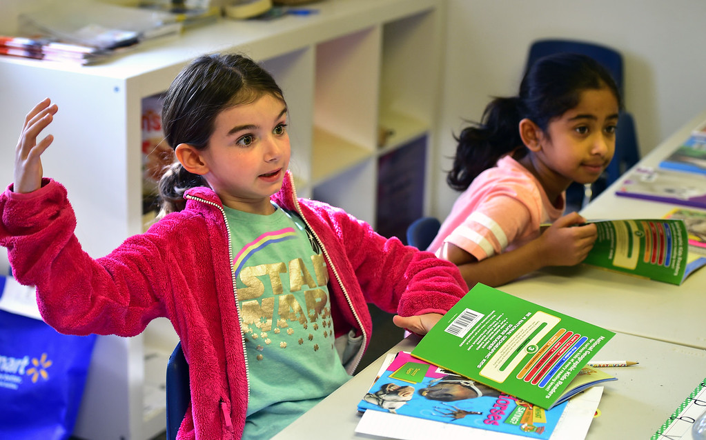 . BROOMFIELD, CO - JULY 31 2018 Ashley Eriksen, left, talks about whales with fellow student Bavya Balaji, during the Jump Start Literacy Camp in the Lutheran Church of Hope in Broomfield on Tuesday July 31, 2018. For more photos go to broomfieldenterprise.com. (Photo by Paul Aiken Daily Camera)