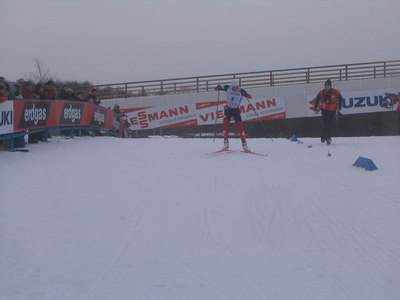 Demong powers into the stadium following his third lap as he chases down Anssi Koivuranta of Finland (credit: Doug Haney/U.S. Ski Team)