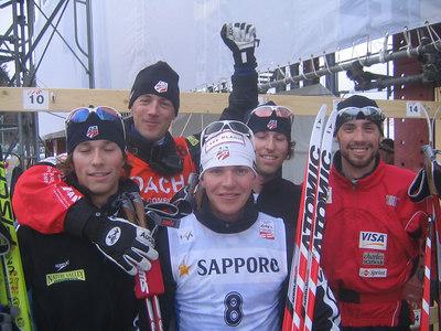 The U.S. Nordic Combined Team including Brett and Eric Camerota, 2003 World Champion Johnny Spillane and coach Lasse Ottesen celebrate with Bill Demong (credit: Doug Haney/U.S. Ski Team)
