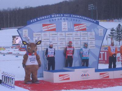 Bill Demong (left) prepares for the medal ceremony (credit: Doug Haney/U.S. Ski Team)