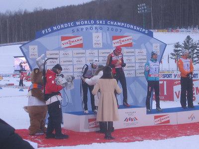 Bill Demong receives his silver medal from FIS President Gian Franco Kasper (credit: Doug Haney/U.S. Ski Team)