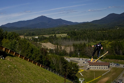 Lindsey Van (Park City, UT) soars down the 100-meter Olympic hill in Lake Placid, NY (credit: ORDA)
