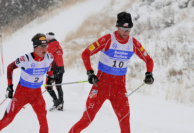 Alex Miller puts a move on Austrian Johannes Weiss on his way to a personal best in a snowy FIS Nordic Combined Continental Cup on the Olympic trails at Soldier Hollow near Midway, Utah. (U.S. Ski Team/Tom Kelly)