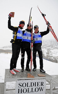 Winner Todd Lodwick (center) shares the podium with third place finisher Steffen Tepel (Germany, left) and Tomaz Druml (Austria, right) after a snowy FIS Nordic Combined Continental Cup on the Olympic trails at Soldier Hollow near Midway, Utah. (U.S. Ski Team/Tom Kelly)