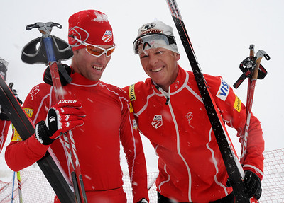 Winner Todd Lodwick (right) congratulates teammate Eric Camerota on his finish in a snowy FIS Nordic Combined Continental Cup on the Olympic trails at Soldier Hollow near Midway, Utah. (U.S. Ski Team/Tom Kelly)