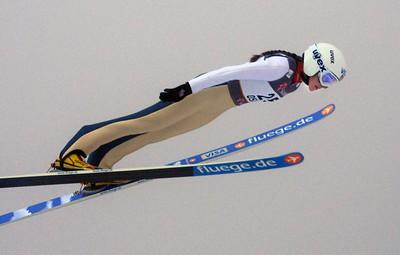 Sarah Hendrickson flies through the fog in the women's ski jumping event at the 2011 FIS Nordic Ski World Championships at Holmenkollen in Oslo. (c) 2011 U.S. Ski Team