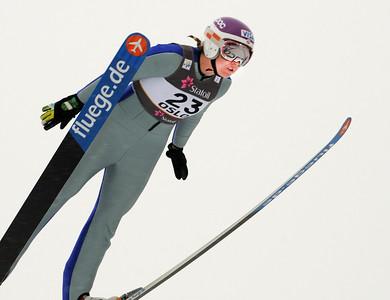 American Abby Hughes jumps in training at the 2011 FIS Nordic Ski World Championships at Holmenkollen in Oslo. (c) 2011 U.S. Ski Team