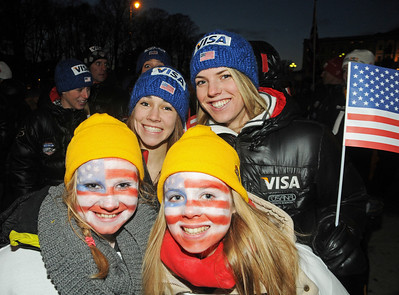 Women's ski jumpers Sarah Hendrickson and Abby Hughes pose with fans during the Opening Ceremony at the 2011 FIS Nordic Ski World Championships at Holmenkollen in Oslo. (c) 2011 U.S. Ski Team