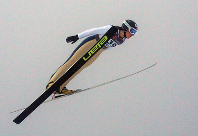 Jessica Jerome flies through the fog in the women's ski jumping event at the 2011 FIS Nordic Ski World Championships at Holmenkollen in Oslo. (c) 2011 U.S. Ski Team