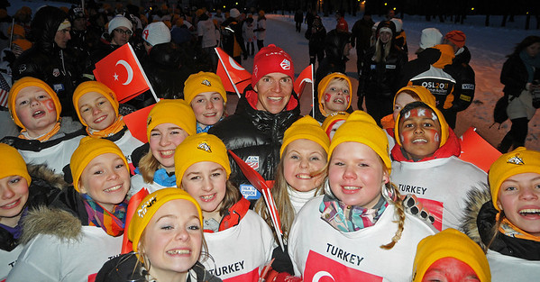 Olympic champion Billy Demong is surrounded by Norwegian schoolchildren supporting the Turkish team as the U.S. Ski Team marches in during the Opening Ceremony at the 2011 FIS Nordic Ski World Championships at Holmenkollen in Oslo. (c) 2011 U.S. Ski Team