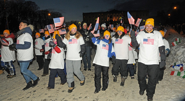 Norwegian schoolchildren with American flags leads the way as the U.S. Ski Team marches in during the Opening Ceremony at the 2011 FIS Nordic Ski World Championships at Holmenkollen in Oslo. (c) 2011 U.S. Ski Team