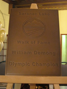 The official bronze plaque honoring Billy Demong is presented at the Walk of Fame ceremony held at the historic Hotel Saranac in Saranac Lake, NY on Saturday, May 14, 2011 (Doug Haney/U.S. Ski Team)