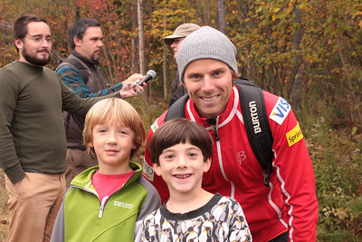 Olympain Andy Newell with local youth Adrian Hayden (l) and Ruben Bernstein (r) during a fundraising launch at Billy Demong's home ski area of Dewey Mountain in Saranac Lake, NY (Doug Haney/U.S. Ski Team)