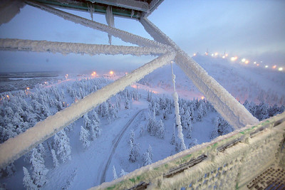 The lights of the ski area glow in the haze as seen from the ski jump towering above the Ruka Ski Area north of Kuusamo, Finland, site of the opening nordic events of the FIS World Cup. (FIS/Horst Nilgen)