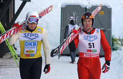 Olympic champions Jason Lamy-Chappuis (left) and Billy Demong walk to the jumps at the Ruka Ski Area near Kuusamo, Finland. (FIS/Egon Theiner)