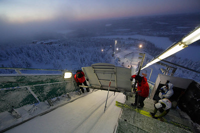 Officials check the ski jump whichtowers above the Ruka Ski Area north of Kuusamo, Finland, site of the opening nordic events of the FIS World Cup. (FIS/Horst Nilgen)