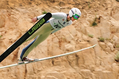 Alissa Johnson flies past the redrock at the U.S. Ski Jumping Championships on the 120 meter hill at the Utah Olympic Park in Park City. (c) 2011 USSA/Tom Kelly