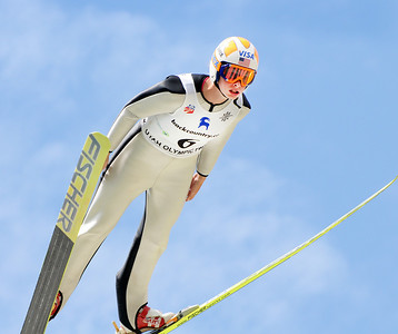 Nina Lussi soars at the U.S. Ski Jumping Championships on the 120 meter hill at the Utah Olympic Park in Park City. (c) 2011 USSA/Tom Kelly