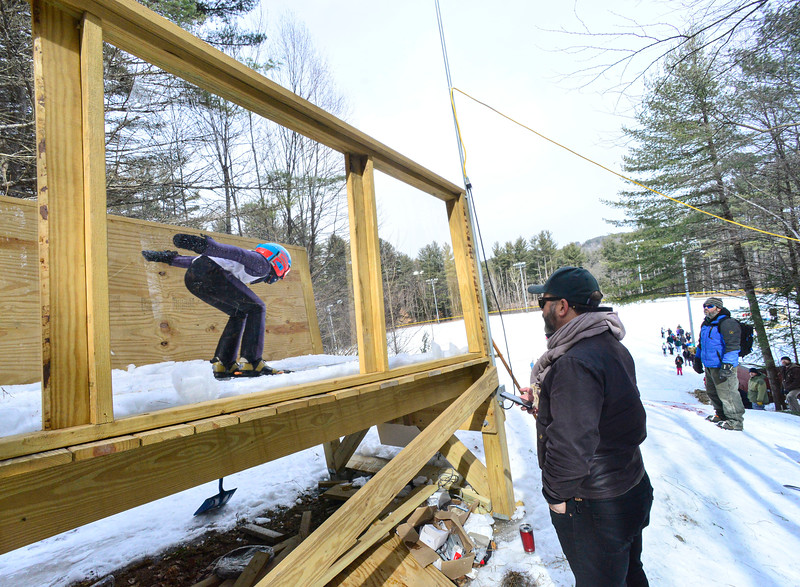 KRISTOPHER RADDER — BRATTLEBORO REFORMER<br /> Marc D'Amore, from Gloucester, Mass., watches jumpers go down the inrun of the 18-meter jump at Living Memorial Park during the first competition in 15 years at the park on Saturday, Feb. 29, 2020.