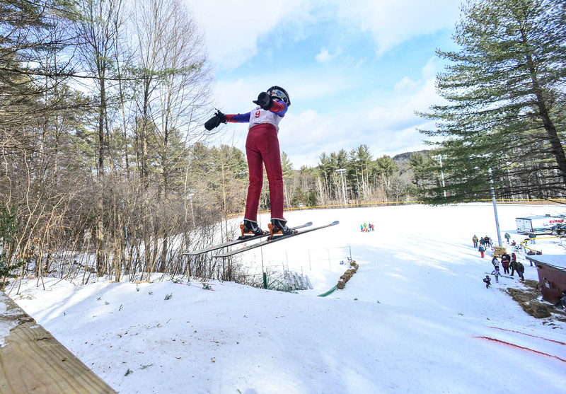 KRISTOPHER RADDER — BRATTLEBORO REFORMER<br /> Benton Smith, from LOC, soars through the air of the 18-meter jump at Living Memorial Park during the first competition in 15 years at the park on Saturday, Feb. 29, 2020.