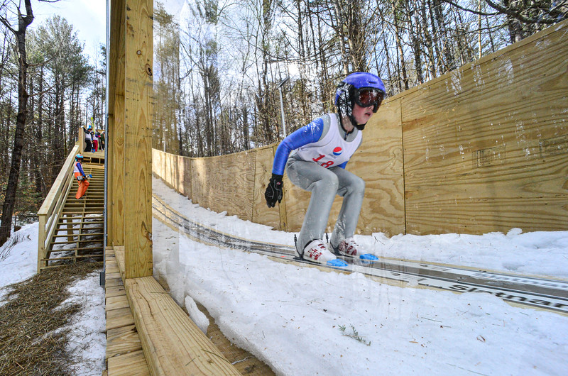 KRISTOPHER RADDER — BRATTLEBORO REFORMER<br /> Max Becker, from the Harris Hill Nordic, goes down the inrun of the 18-meter jump at Living Memorial Park during the first competition in 15 years at the park on Saturday, Feb. 29, 2020.