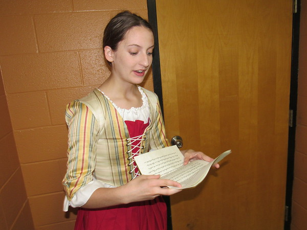 """CATHY SPAULDING/ Muskogee Phoenix<br /> Muskogee High School freshman Emma Watson reads from letters and other primary sources in her National History Day performance """"Founding Mothers."""" She and classmates Asharia Jones and Kylie Gioletti will compete in the National History Day Contest, June 10-14."""