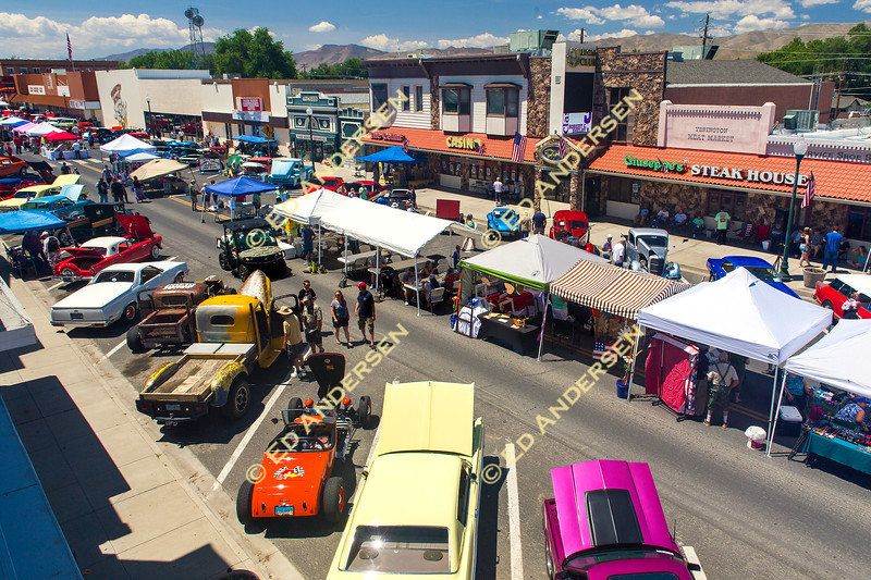 Craft and food vendors line the street between hundreds of classic cars, raising funds for local agencies.