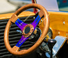 A wooden steering wheel accessorizes the interior of a classic convertible.