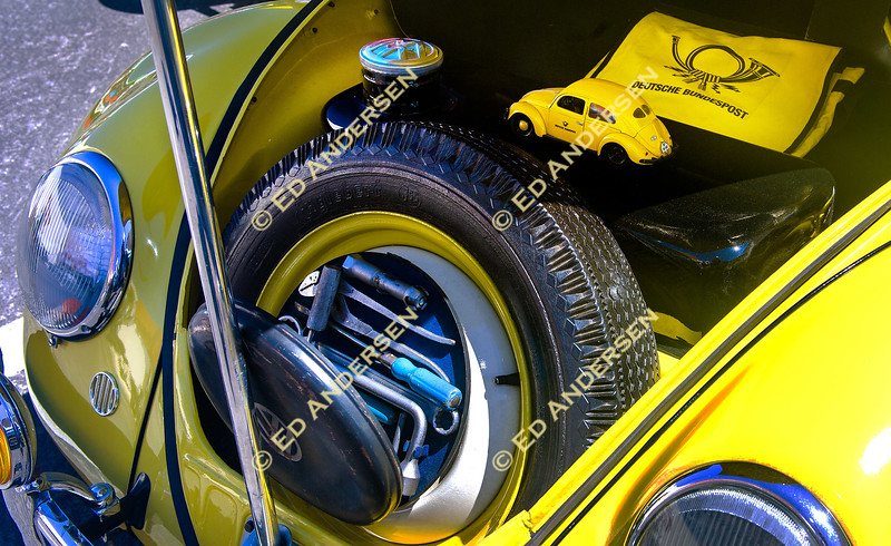 Jim Barnett's 1950 Volkswagen Beetle with its original toolkit and a miniature replica are displayed.