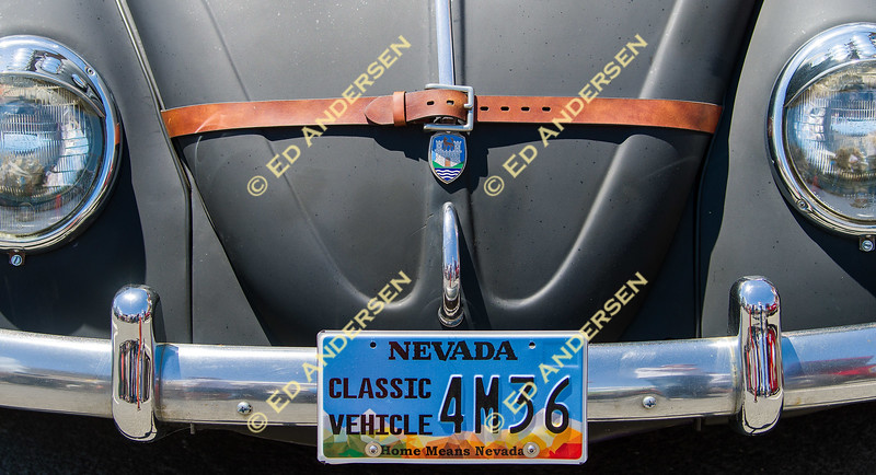 A belt wraps the hood of a 1963 Volkswagen Beetle ragtop owned by Eric Chichester.