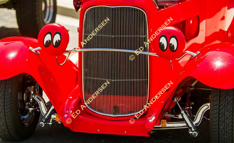 Baby Moon headlamp covers adorn a red roadster.