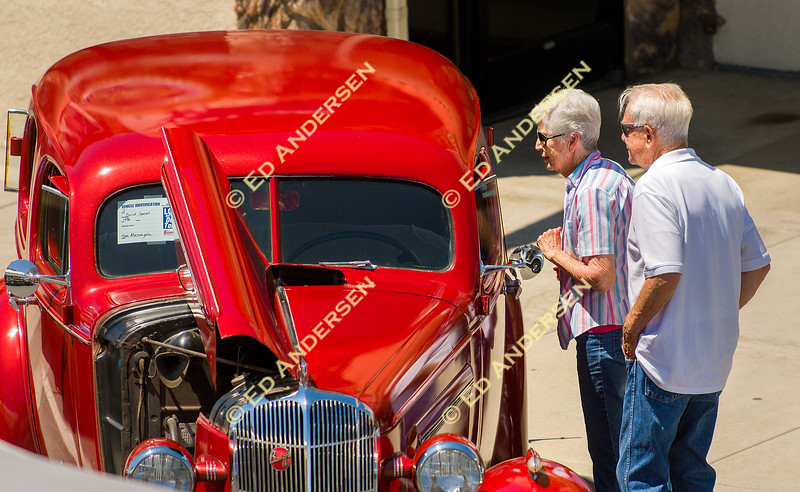 Car enthusiasts peek inside a 1936 Buick Special owned by Tim Massengale.
