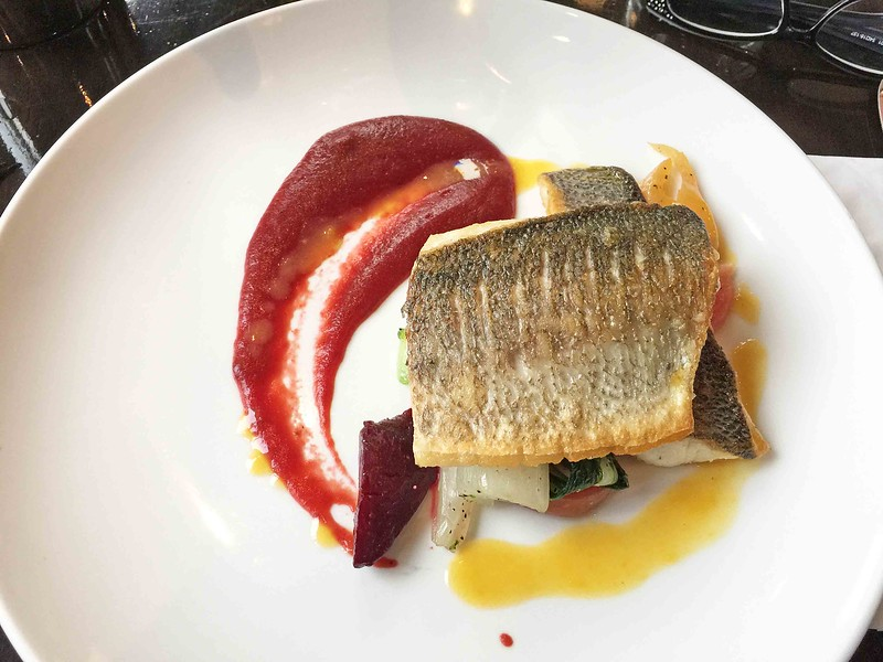 Pan fried fillet of sea bass with trio of beetroot, beetroot confit puree, and mint and orange sauce.