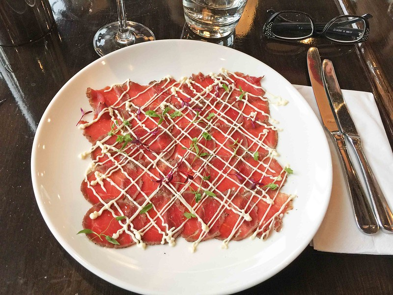 Beef carpaccio: seared beef, mustard dressing and parsley cress.