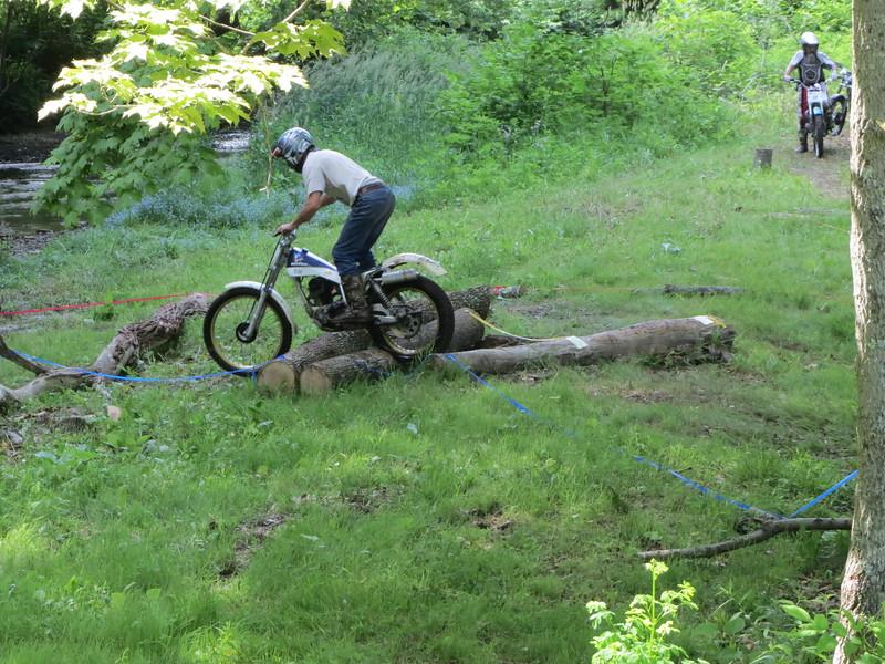 Trials rider navigating obstacles.