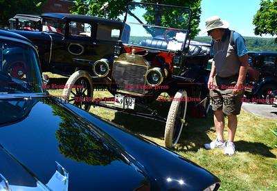 6/18/2016 Mike Orazzi | Staff Adam Szczepankski looks over classic cars during the annual Klingberg Auto Show in New Britain on Saturday.