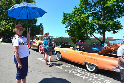 6/18/2016 Mike Orazzi | Staff Marie Humpage shields herself from the sun while looking over classic cars during the annual Klingberg Auto Show in New Britain on Saturday.