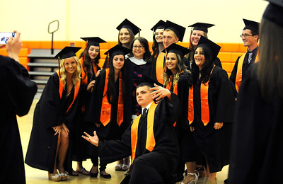 6/8/2016 Mike Orazzi | Staff Terryville High Schools graduate John Leavenworth photo bombs Wednesday night at THS in Plymouth.