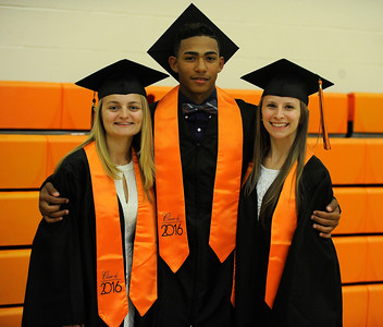 6/8/2016 Mike Orazzi | Staff Terryville High Schools graduates Ariana Katiewicz, Ariel Batista and Kayla Danko Wednesday night at THS in Plymouth.