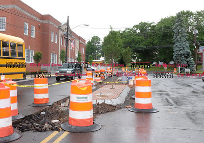 060816 Wesley Bunnell | Staff  A new center divider is being installed on Main St. in Berlin near the intersection with Farmington Ave.