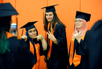 6/8/2016 Mike Orazzi | Staff Terryville High Schools graduates Abbey Elias, Cat Gullotta and Tori Campbell Wednesday night at THS in Plymouth.