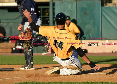 060916 Wesley Bunnell | Staff  New Britain took on the Somerset Patriots on Thursday evening at New Britain Stadium . Michael Crouse #14 is safe at home on a suicide squeeze.