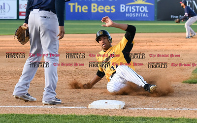 060916 Wesley Bunnell | Staff  New Britain took on the Somerset Patriots on Thursday evening at New Britain Stadium . Michael Crouse #14 slides safely into 3rd.